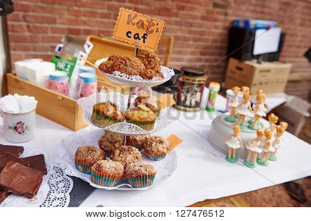 AMSTERDAM, NETHERLANDS on APRIL 26, 2015. Flea market cookie food cakes at Queen's Day or King's day, Dutch annual national holiday, in the street Amsterdam, Holland