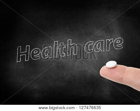 Health care written on a blackboard