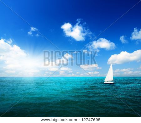 sailboat sky and ocean