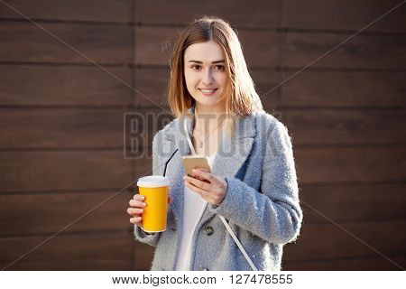 young beautiful happy stylish hipster girl with cocktail, smoozy drink.