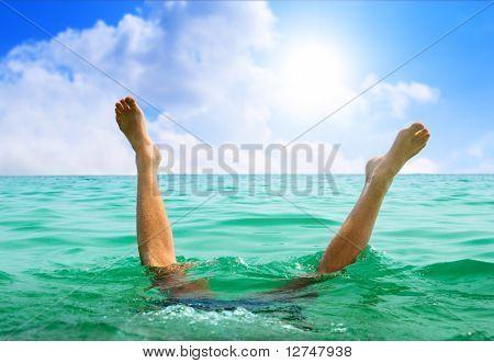 man jumping in ocean
