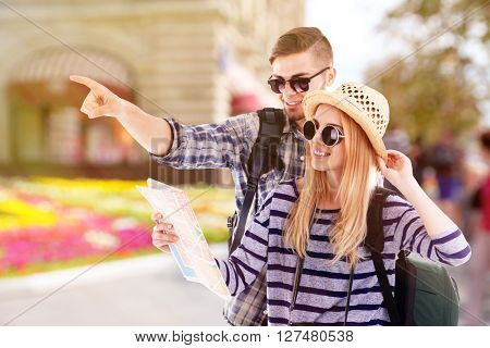 Young couple of travelers, outdoors