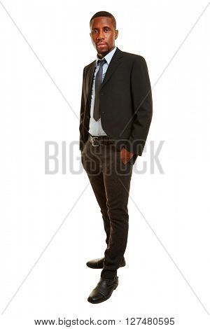 Smiling african man as businessman in a suit in a full body shot