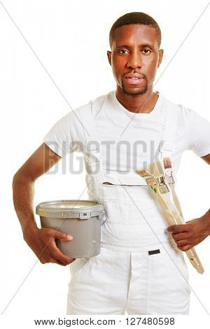 Painter with brush and paint can in a white jumper