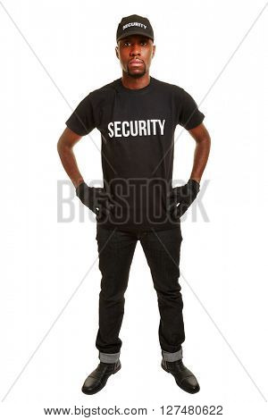 Security guard from security firm standing with arms akimbo