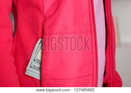 Cash in the red jacket pocket, close up