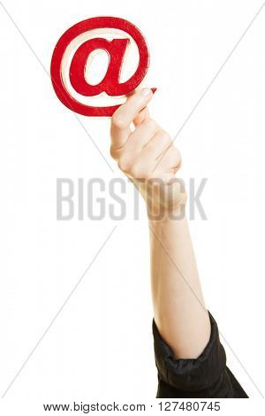 Hand holding at sign as symbol for email and internet