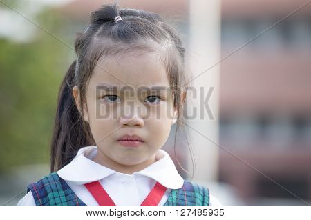 childhood and education concept  Crying child in school