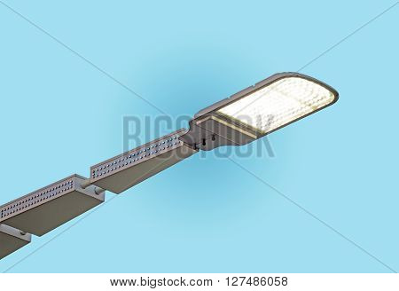 LED street lamps post on blue sky background