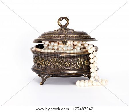 Casket with pearl beads on white background
