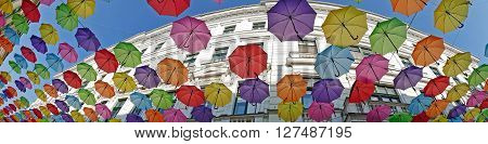 Panorama and background with colored umbrellas on one street in Timisoara Romania.
