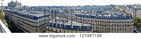 PARIS FRANCE - OCTOBER 11 2015: Panorama with aerial view from the terrace of store Printemps with roofs and Madeleine church.