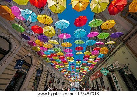TIMISOARA ROMANIA - APRIL 22 2016: Street with colored umbrellas in Timisoara Romania