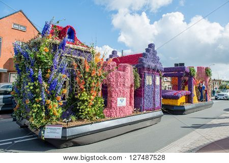 HILLEGOM, THE NETHERLANDS - APRIL 23, 2016: Platform with a frame made in a form of fairy houses and decorated with flowers. Part of the  traditional flowers parade