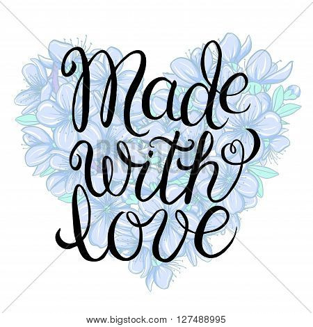 Made with love - hand lettering calligraphic inscription on the floral background of cherry blossom in heart shape