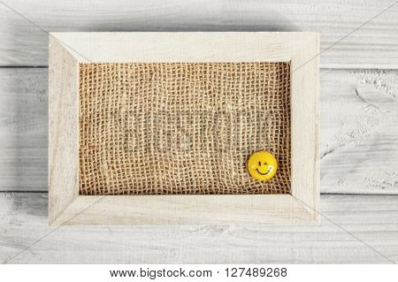 Frame with smiles on a wooden board.