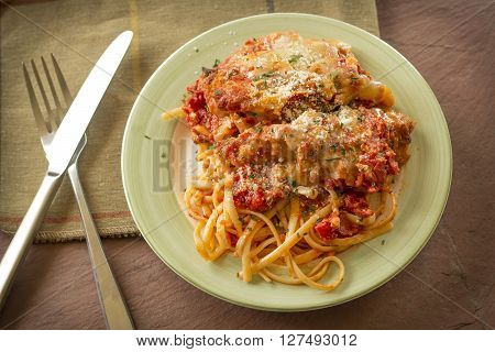 Hot and crispy chicken parmesan in savory red tomato sauce