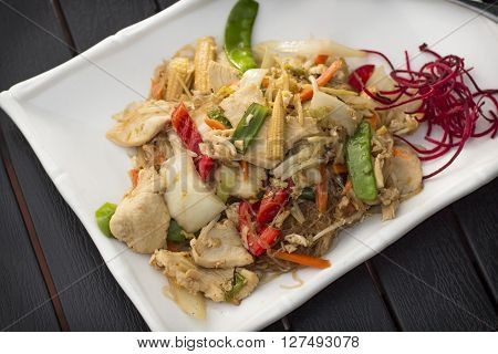 Spicy Thai dinner dish Pad woon sen chicken with mixed vegetables