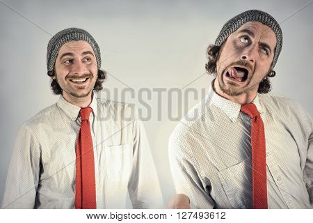 Twin adult men with beards making silly facial expressions