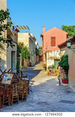 ATHENS, GREECE - AUGUST 27, 2015: Small street with color houses and stony road at old town of Athens, Greece