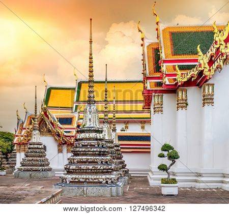 Wat Pho Temple at sunset in Bangkok Thailand. Wat Pho known also as the Temple of the Reclining Buddha.