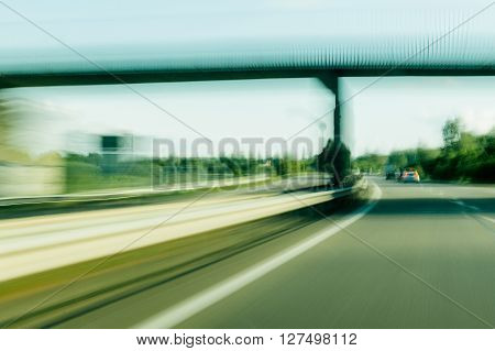 Moving fast on French highway under a breedge