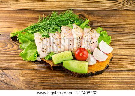 Sliced fresh pork lard fresh produce vegetables on the wooden board
