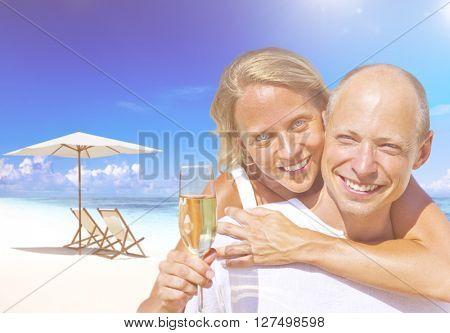 Couple Celebrating Beach Concept