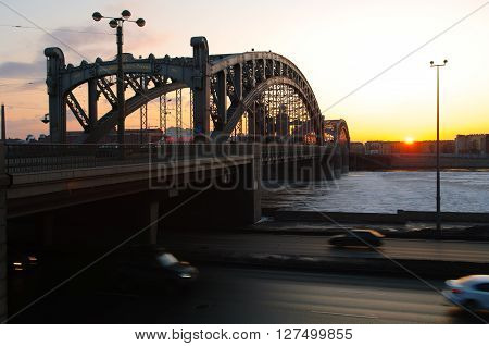 Night life of the big city. The historical Finland railway bridge is a drawbridge across the Neva river in St. Petersburg.  Urban landscape. White nights of St. Petersburg. View of the city at sunset.