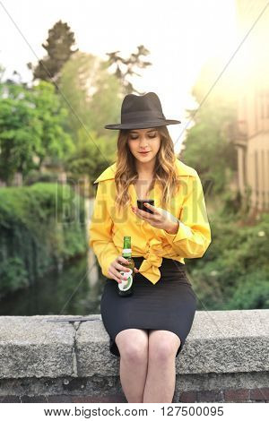 Happy woman drinking a beer