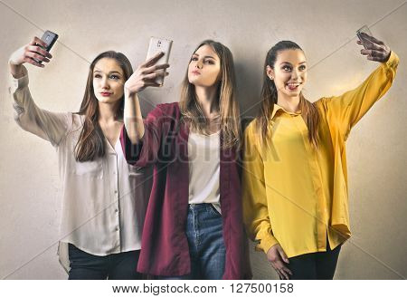 Teenagers doing selfies