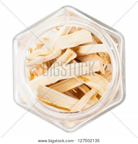 Dried ginger root in glass bottle, isolated over white background