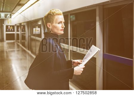Businesswoman Lifestyle Commuter Newspaper Concept