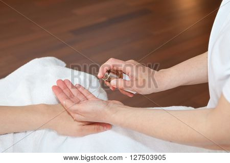 Hand massage, therapist applying softening tonic