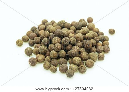 Pile of dry seeds on white background