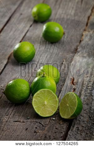 Close-up of fresh healthy limes on table