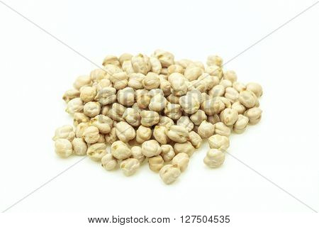 Close-up of white rw chickpeas on white background.Isolated.