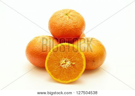 Close-up of several tangerines on white background.Isolated.