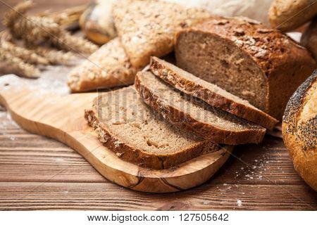 Freshly baked bread assortment on wooden surface