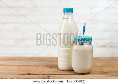 Milk bottle on a wooden table