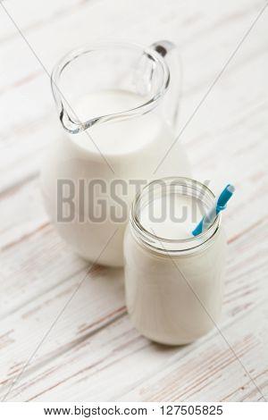Milk jar on a wooden table