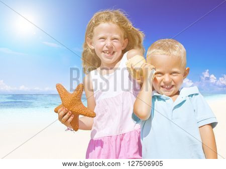 Brother and Sister having fun on the Beach.
