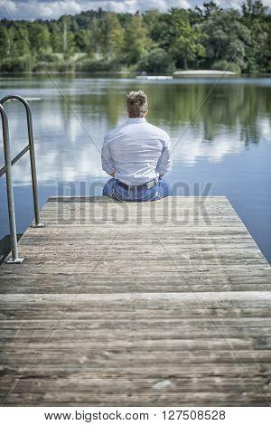 An image of a man at the lake