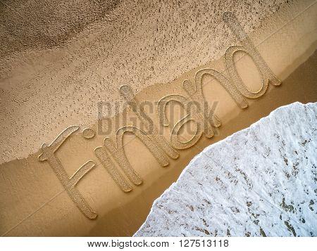 Finland written on the beach