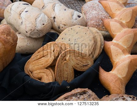 Bakery goodies at the farmers market on a vendor's table.