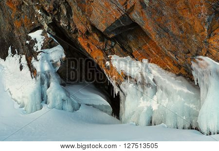 Frost before grotto in the rock. Beautiful winter landscape in the Lake Baikal.