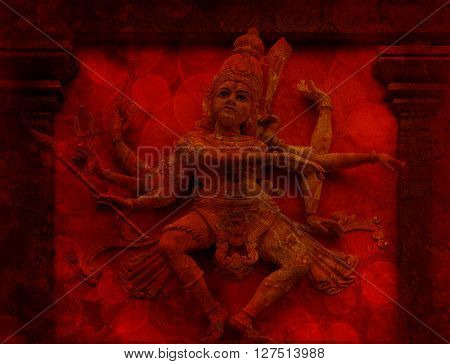 Nataraj Dancing Form of Lord Shiva Hindu God Statue on Temple Exterior Wall Relief in Red Grunge Texture Background