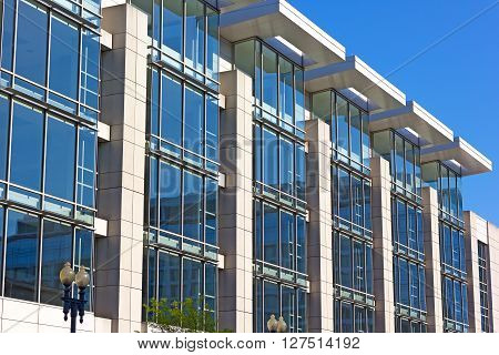 WASHINGTON DC, USA - APRIL 16: Architectural details of Convention Center building in Washington DC on April 16, 2016. Building windows illuminated by the light coming through roof openings.