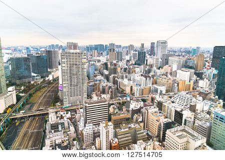TOKYO, JAPAN - 26 NOVEMBER 2015 - The Tokyo  Kanto region and Tokyo prefecture, is the first largest metropolitan area in Japan. Downtown Tokyo is very modern with many skyscrapers.