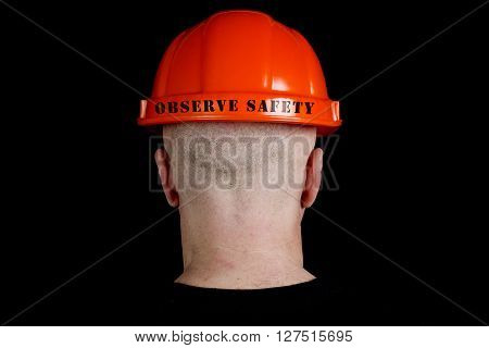Construction worker in hard hat with an inscription observe safety on gray background